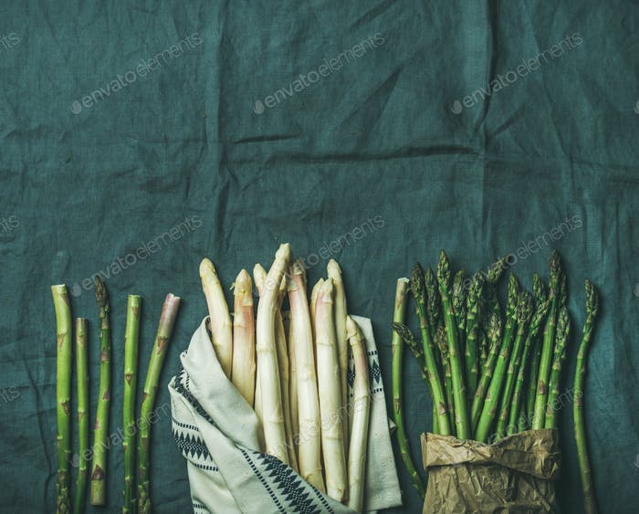 Fresh green and white asparagus in towel, copy space