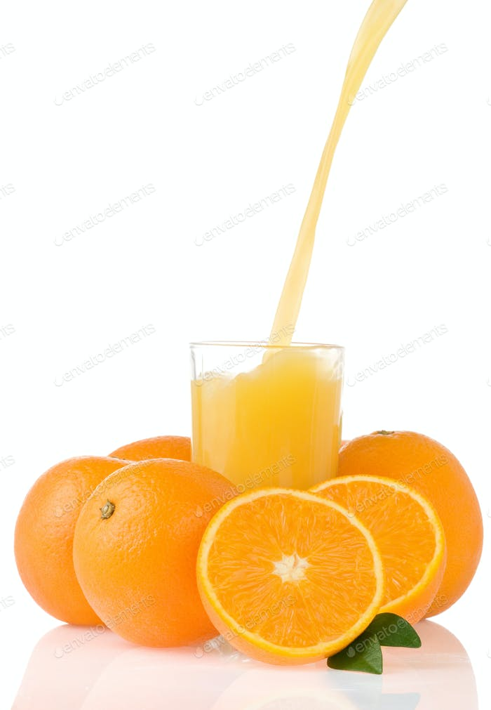 flowing juice and orange isolated on white