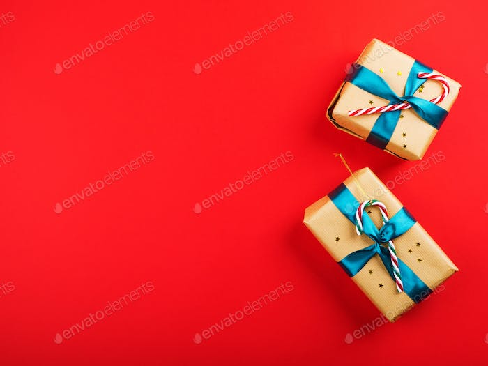 Gift boxes with green ribbon on red bold color