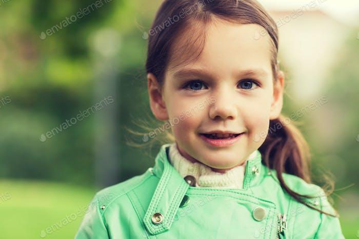 happy beautiful little girl portrait outdoors