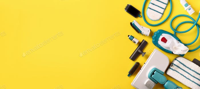 Set with modern professional steam cleaners on yellow background. Top view, flat lay. Banner with