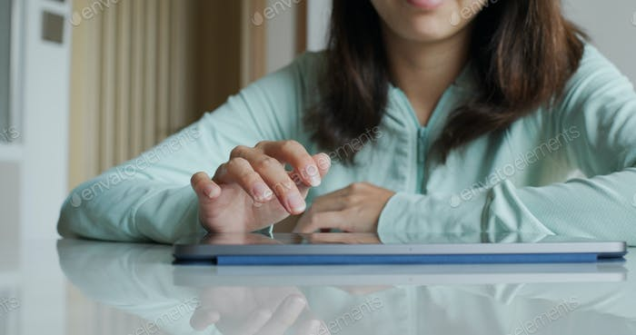 Woman touch on tablet computer at home