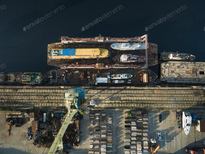aerial view of various ships in industrial harbour
