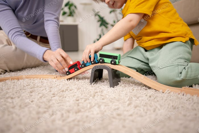 Playing with toy train on toy railway