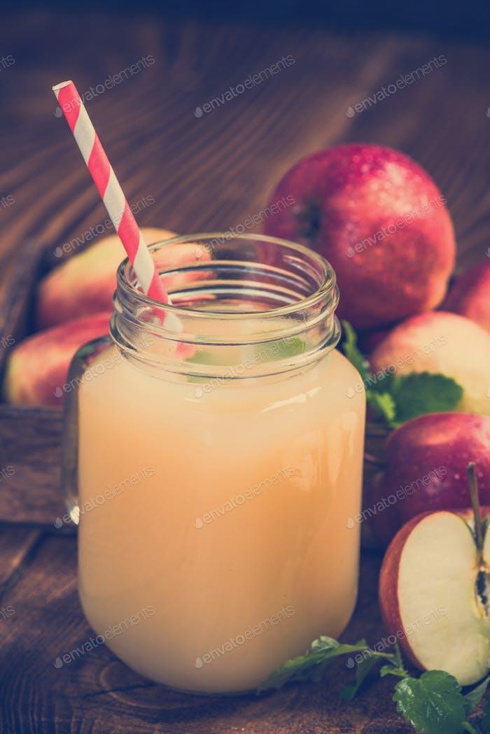 Apple juice in jar, freshly pressed cloudy juice