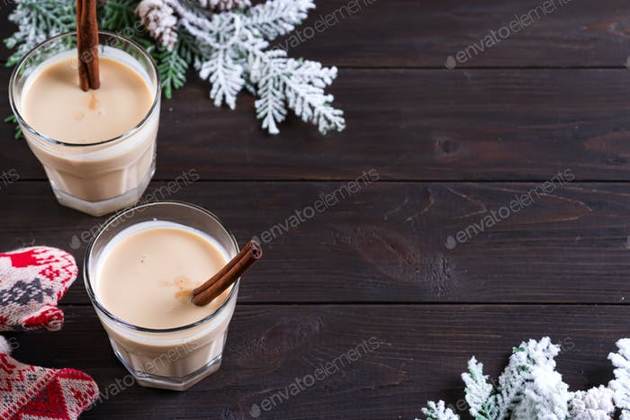 Eggnog Gemadinha is an alcoholic beverage or cocktail on dark wooden background, Christmas dinner