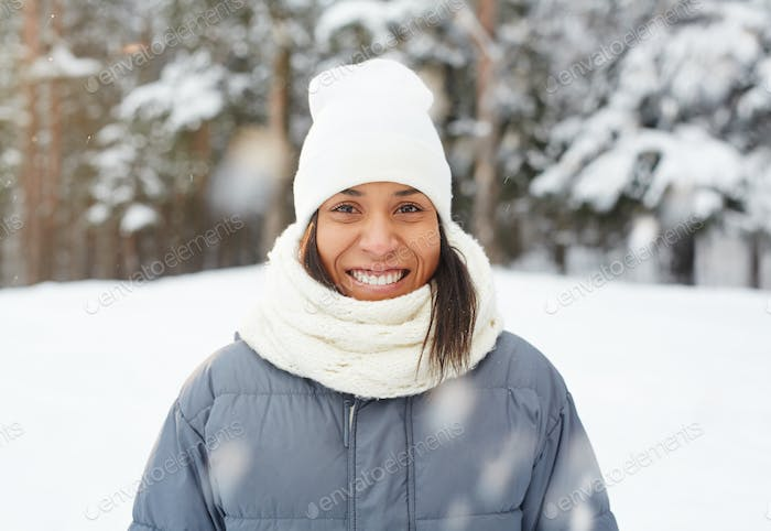 Mixed race girl under falling snow