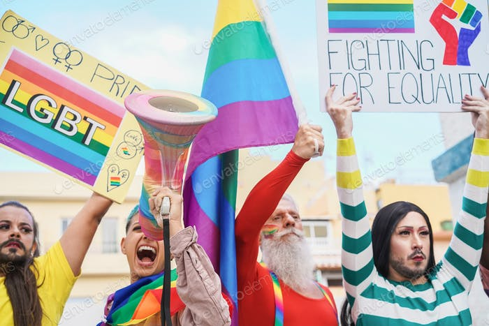 Gay and transgender people protest at lgbt pride event for equality rights outdoors