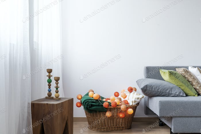 Room corner with wicker basket