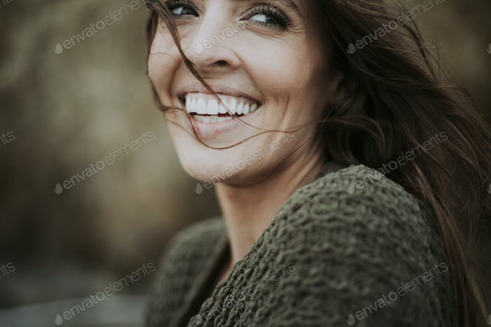 Carefree smiling woman outdoors alone