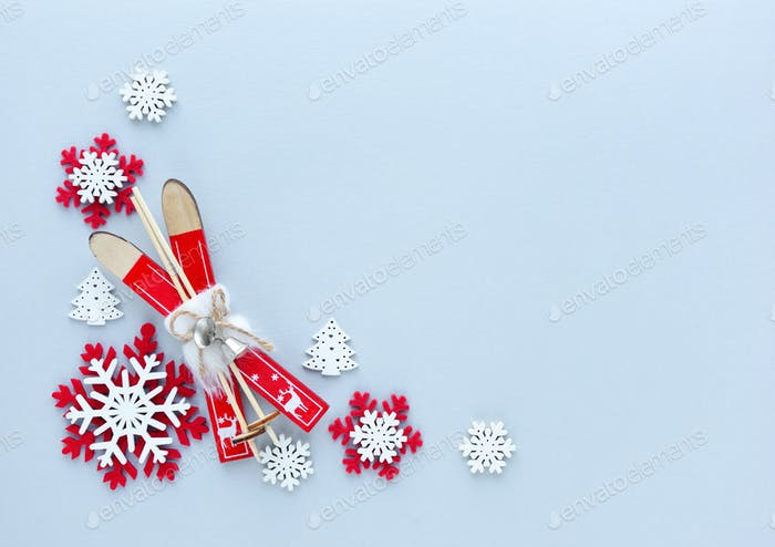 Snowflakes and ski on a pastel blue background