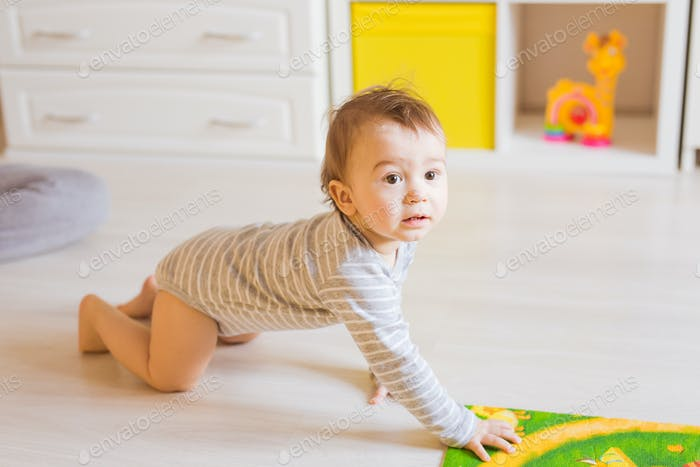 crawling funny baby boy indoors at home