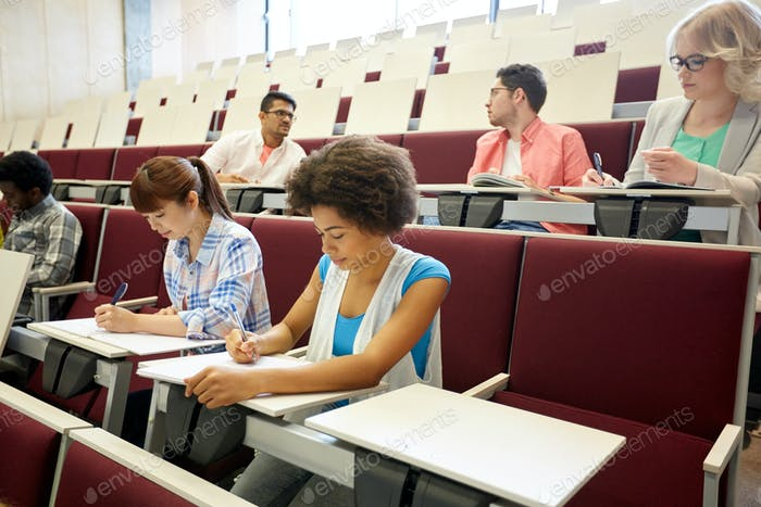 Thumbnail for group of students with notebooks at lecture hall