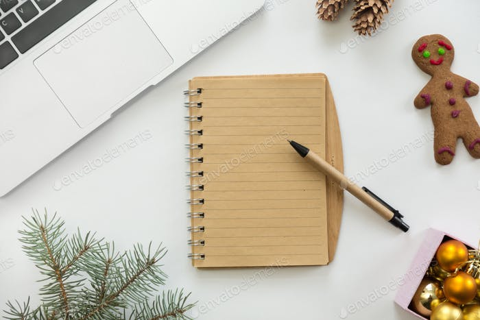 Flat view of notebook in the centre of Christmas decoration