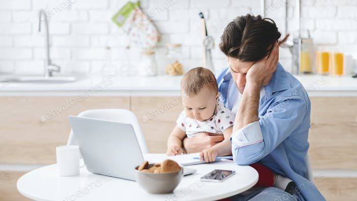 Millennial man tired of working and taking care of baby