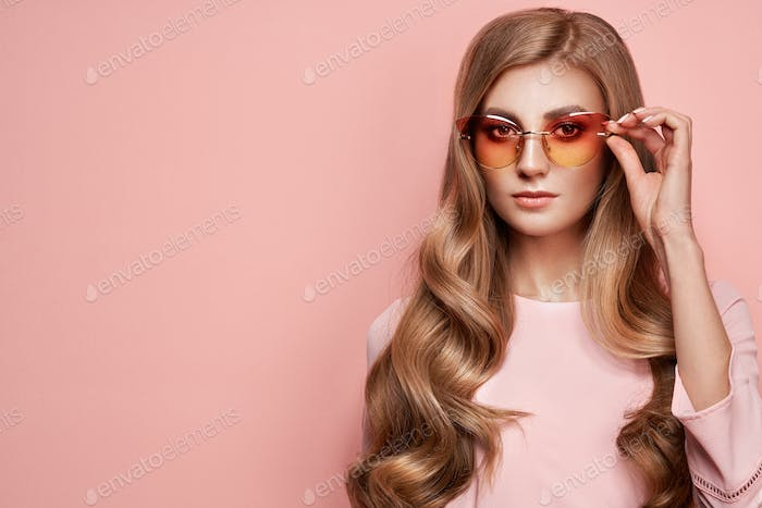 Young woman in elegant sunglasses