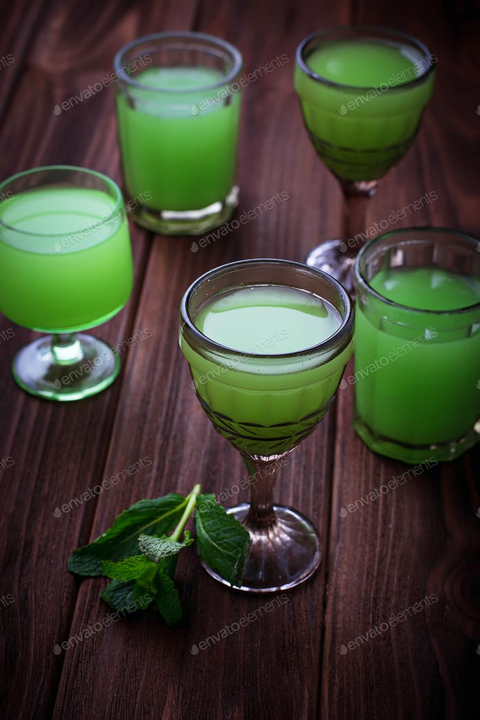 Glasses of green drink with mint