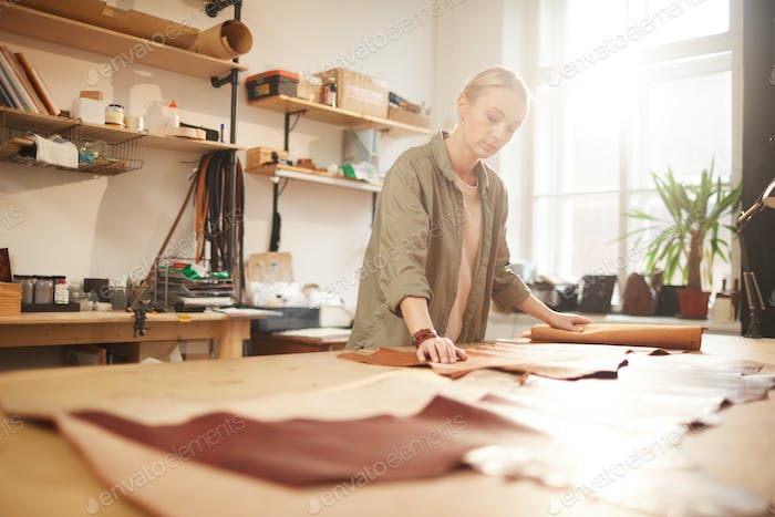 Woman Rolling Out Material For Craft