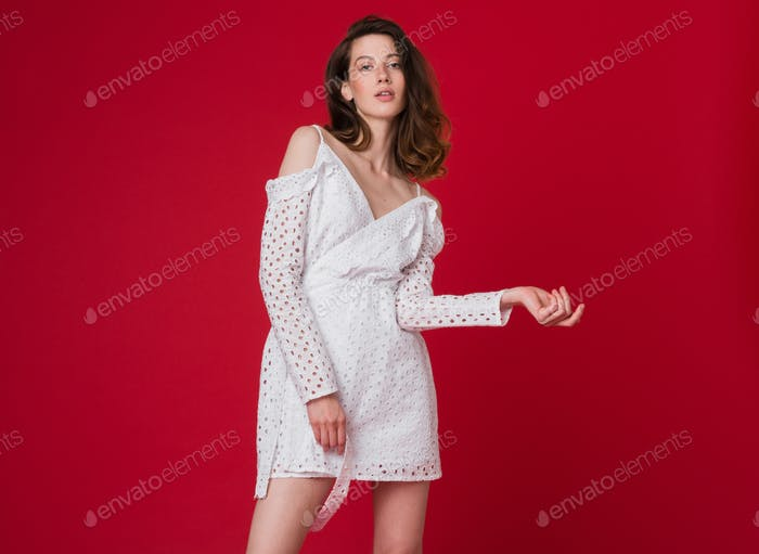 stylish woman in summer fashion trend dress on red background