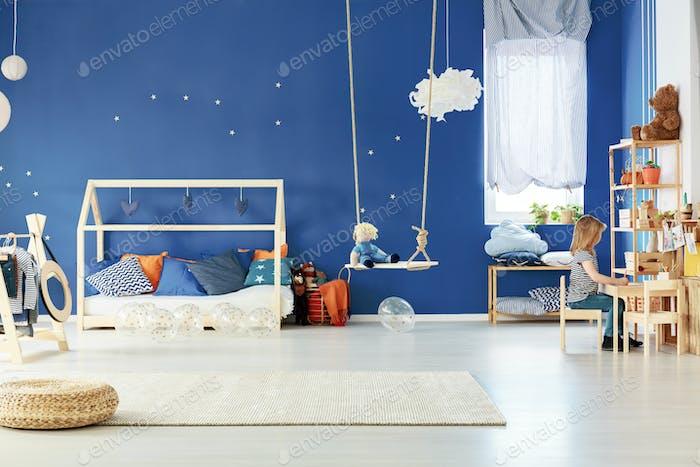 Trendy child room with table