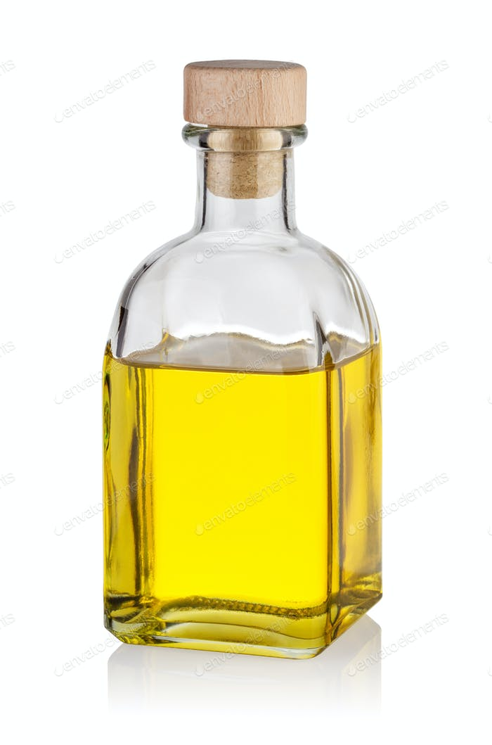 Bottle of yellow oil with cap