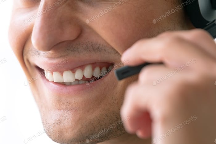 Close-up of Caucasian male customer service executive talking on headset in office
