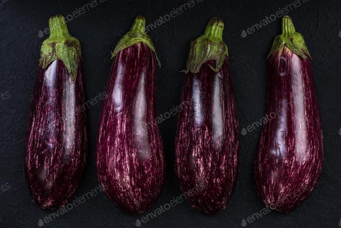 Pink or purple aubergine on dark slate