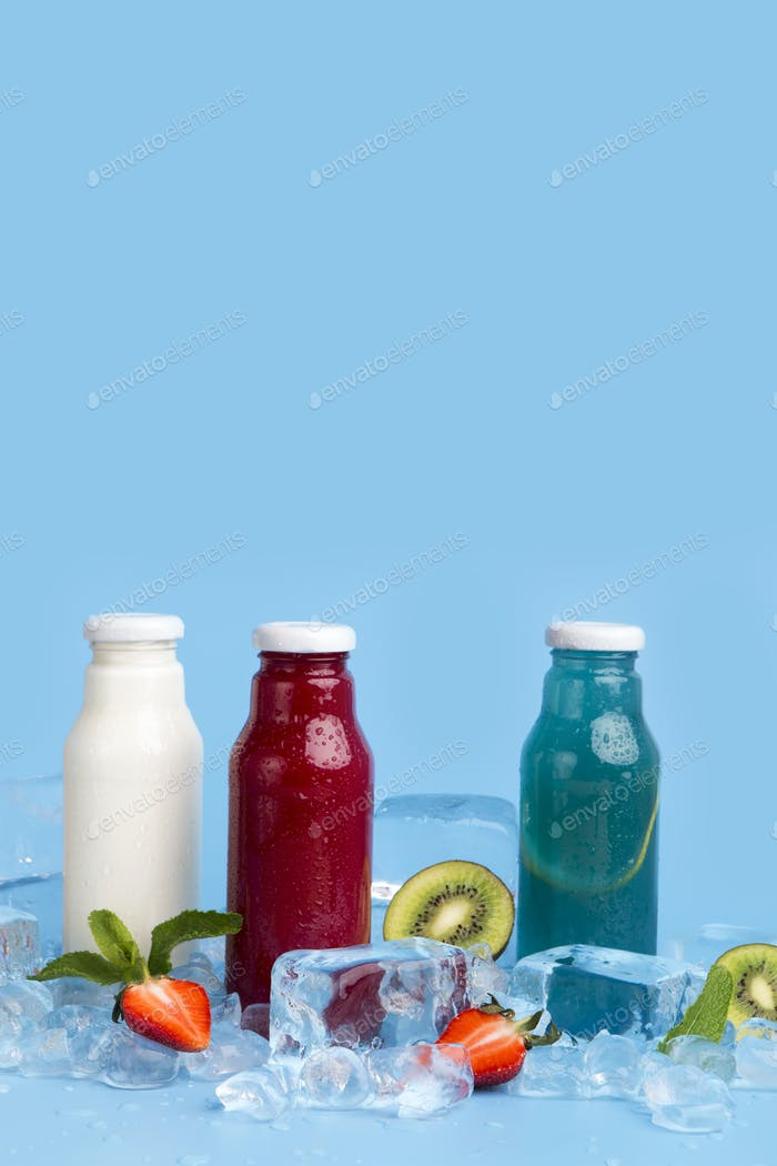 Healthy detox drinks of fresh ingredients on blue background