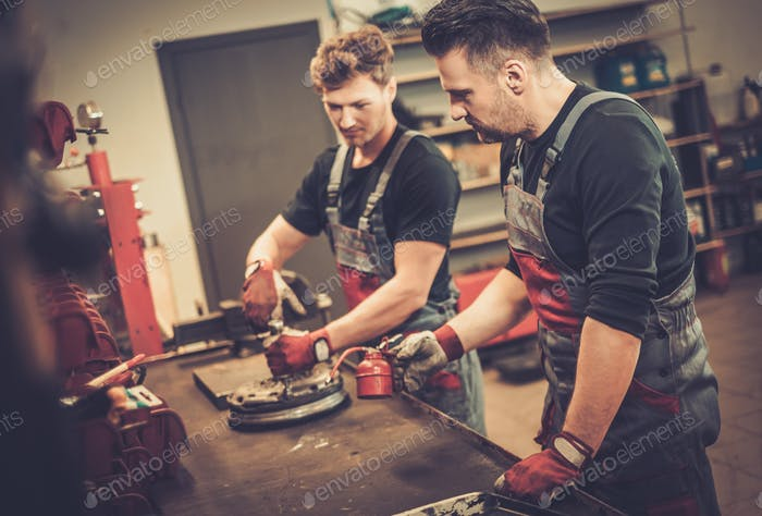 Thumbnail for Professional car mechanics working at work table in auto repair