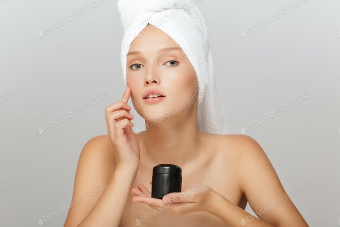 Portrait of young beautiful lady without makeup with white towel