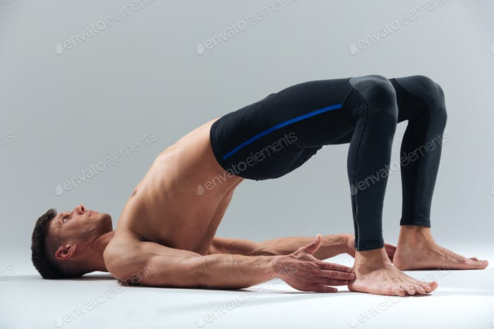 Fitness man doing yoga pose