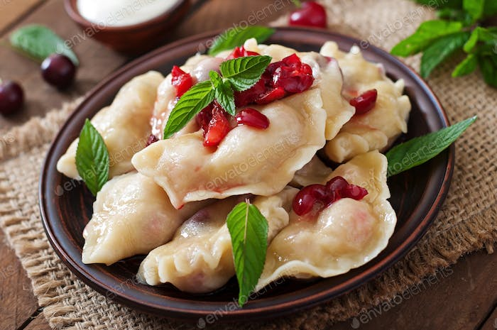 Delicious dumplings with cherries and jam