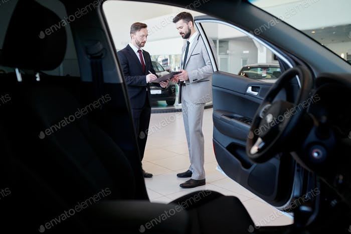 Car Salesman Talking to Client