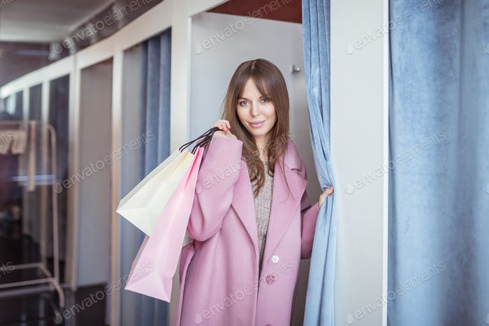 Attrractive girl with shopping bags