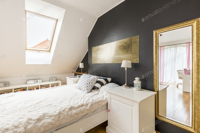Single bed and a nighstand in bedroom