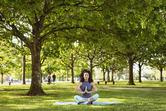 Woman performing yoga in the park