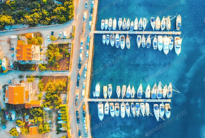 Aerial view of boats and yachts in port in old city at sunset