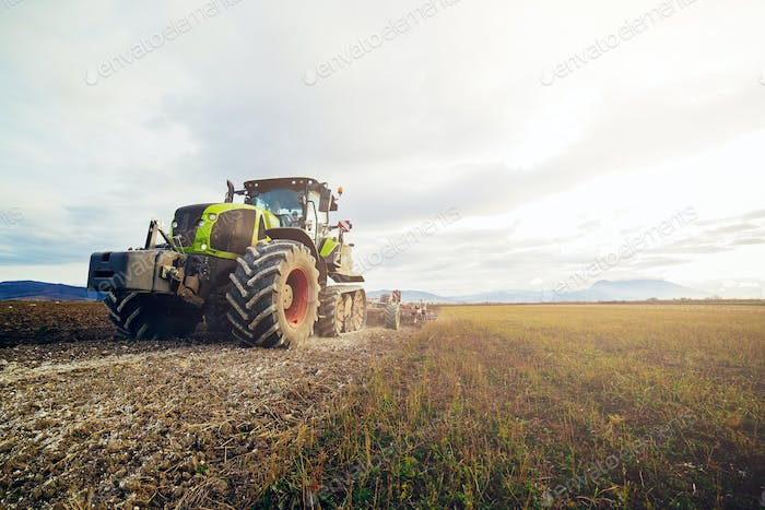 Tractor preparing the land for planting