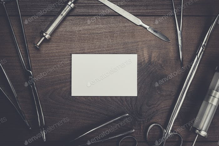 surgical armaments and blank notebook background