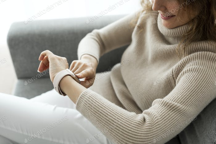 Woman looking at smartwatch wearable technology