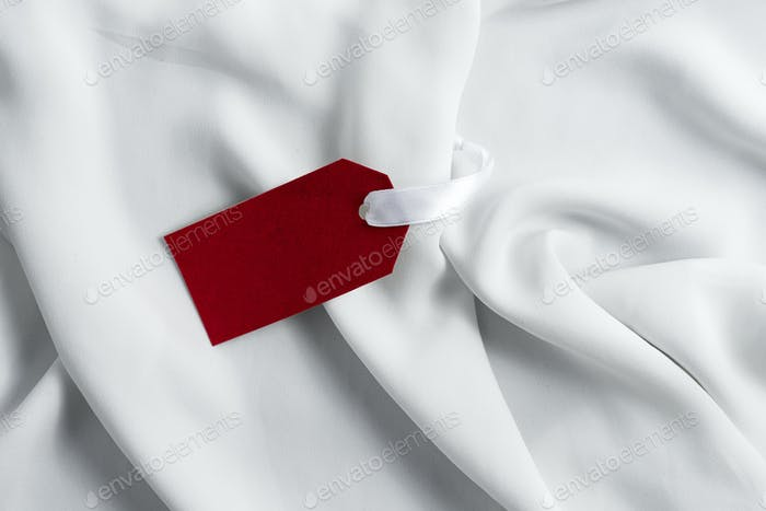 Simple Tag Mockup for presenting branding or logo concepts in fashion industry on white silk