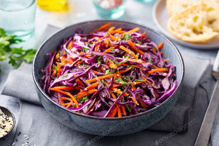 Red Cabbage Salad, Coleslaw in a Bowl. Grey Background. Close up.