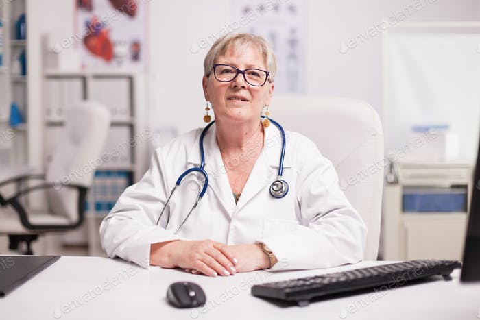Senior medical practitioner with stethoscope
