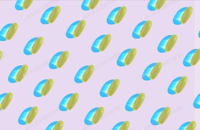 Schönes Muster von gelben Vitaminen auf rosa Hintergrund