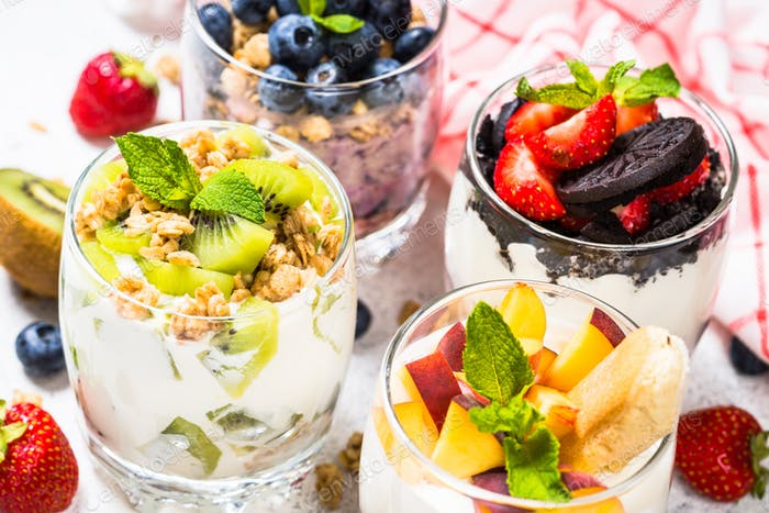 Fruit Dessert in glasses with yogurt and berries