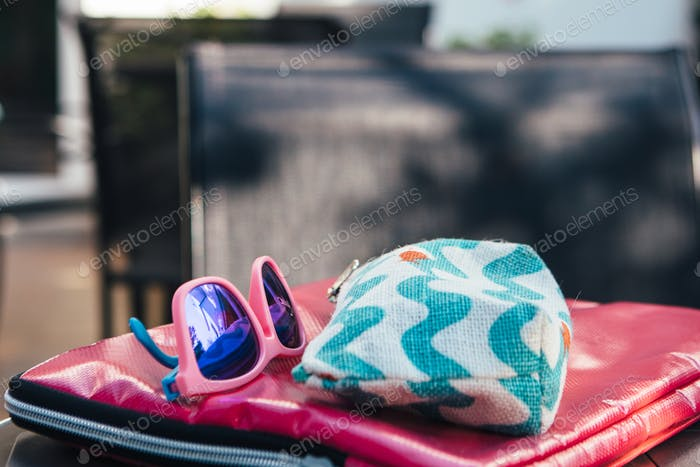Sunglasses and cosmetic bag