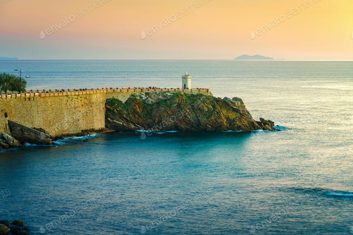 Piombino twilight panoramic view on piazza bovio lighthouse and