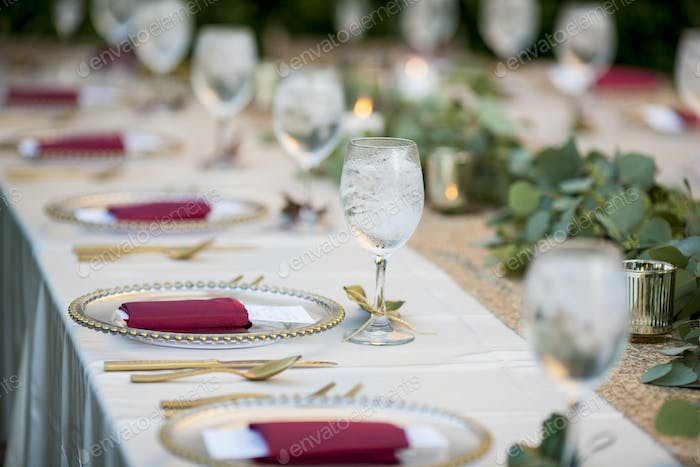 Elegant table set up for dinner for either wedding reception or