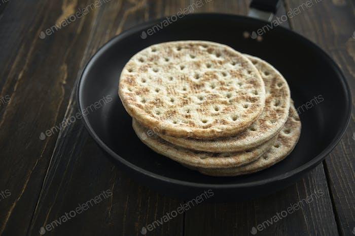 Stack of soft unleavened flatbread on pan