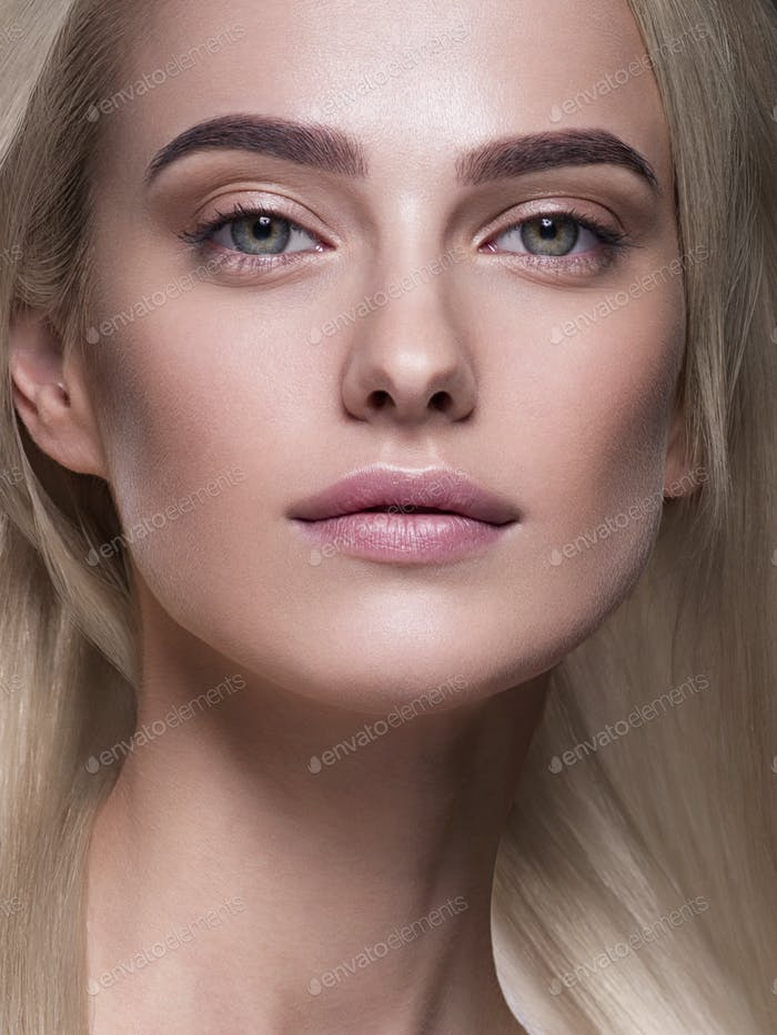 Natural make up blond hair woman close up face beauty portrait